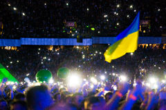 KYIV, UKRAINE - JUNE 21: Ukrainian flag on concert of Okean Elzy Stock Images
