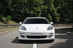 Kyiv, Ukraine, June 25, 2015; White Porsche. Porsche Panamera on the background of trees stock images