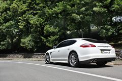 Kyiv, Ukraine, June 25, 2015; White Porsche. Porsche Panamera on the background of trees royalty free stock photos