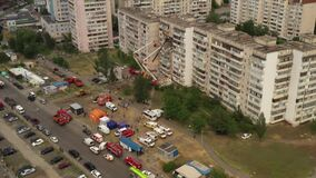 Kyiv, Ukraine - 21.06.2020: A lot of rescue equipment and two tower manipulators work at the site of the explosion of an