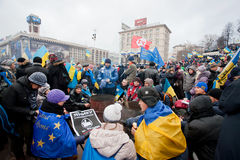 KYIV, UKRAINE: Many people warm themselves by the fire on the cold occupying Maidan square during anti-government protest Stock Photography