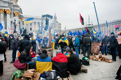 KYIV, UKRAINE: Many students sitting by the barrel with fire on the anti-government protest Royalty Free Stock Photography