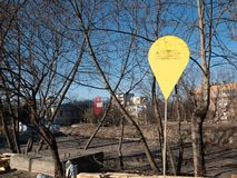 Construction site yellow sign with inscription Monument of heavenly hundred memory of dignity revolution in Kiev. KYIV, UKRAINE - MARCH 13, 2019: Construction royalty free stock image