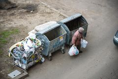KYIV, UKRAINE MARCH 31, 2019: A homeless man looking for food in a garbage dumpster. Urban Poverty.  royalty free stock images
