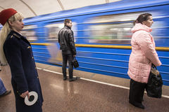 KYIV, UKRAINE - March 30, 2012. Metro worker of on the platform while the train Royalty Free Stock Images