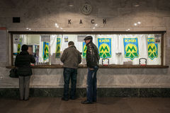 KYIV, UKRAINE - March 30, 2012. People buy a ticket in the metro Royalty Free Stock Photography