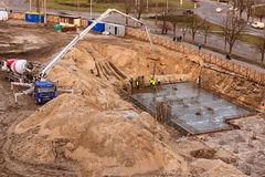 Top view of pouring the foundation for the future multi-story building with using special vehicles royalty free stock photos