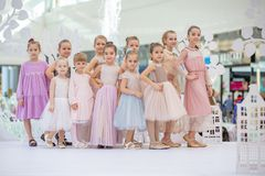 Kyiv, Ukraine March 03.2019. UKFW. Ukrainian Kids Fashion Day. little model girls defile on the podium at the fashion show royalty free stock photos
