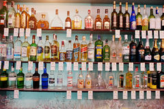 KYIV, UKRAINE - MARCH 25, 2016: Various alcoholic beverages bott. Les in the bar on the shelf Stock Photo