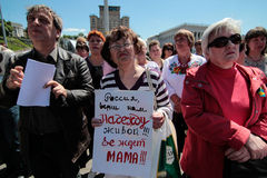 KYIV, UKRAINE - MAY, 11, 2015: Activist holds a poster calling for the release of captured pilot Nadia Savchenko Royalty Free Stock Photo
