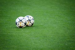 UEFA Champions League final match 2018. KYIV, UKRAINE - MAY 26, 2018: The Champions League ball lies on the lawn before the 2018 UEFA Champions League final royalty free stock images