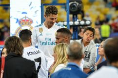 KYIV, UKRAINE - MAY 26, 2018: Cristiano Ronaldo with his son aft. Er the victory in the final of the UEFA Champions League 2018 in Kiev  match between Real stock image