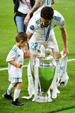 KYIV, UKRAINE - MAY 26, 2018: Isco and son celebrate the victor. Y in the final of the UEFA Champions League 2018 in Kiev match between Real Madrid and Liverpool stock photos