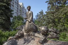 KYIV, UKRAINE - May 9, 2018: a monument to the fairy-tale hero Kotigoroshko in embroidery, which was pressed by the mace of Snake royalty free stock images