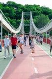Kyiv, Ukraine - May 18, 2019. Park bridge over the Dnipro river. People walking along the pedestrian bridge on weekend stock photos