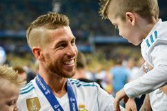 KYIV, UKRAINE - MAY 26, 2018: Sergio Ramos with son of Real Madr. Id celebrate the victory in the final of the UEFA Champions League 2018 in Kiev match between royalty free stock photo