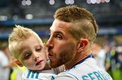 KYIV, UKRAINE - MAY 26, 2018: Sergio Ramos with son of Real Madr. Id celebrate the victory in the final of the UEFA Champions League 2018 in Kiev  match between Royalty Free Stock Image