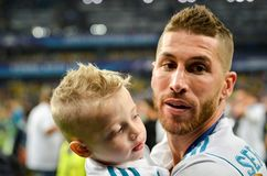 KYIV, UKRAINE - MAY 26, 2018: Sergio Ramos with son of Real Madr. Id celebrate the victory in the final of the UEFA Champions League 2018 in Kiev  match between Royalty Free Stock Photos