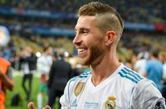 KYIV, UKRAINE - MAY 26, 2018: Sergio Ramos with son of Real Madr. Id celebrate the victory in the final of the UEFA Champions League 2018 in Kiev match between royalty free stock photography