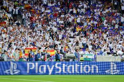 KYIV, UKRAINE - MAY 26, 2018: Sony Playstation logo on the backg. Round of Real Madrid fans before the 2018 UEFA Champions League final match, Ukraine Royalty Free Stock Photos