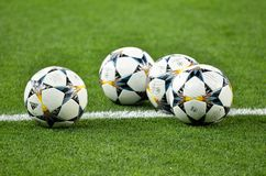 KYIV, UKRAINE - MAY 26, 2018: Three Champions League ball lies o. N the lawn before the 2018 UEFA Champions League final match between Real Madrid and Liverpool stock photo