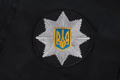 KYIV, UKRAINE - NOVEMBER 22, 2016: Patch and badge of the National Police of Ukraine. National Police of Ukraine uniform. KYIV, UKRAINE - NOVEMBER 22, 2016 Royalty Free Stock Image