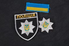 KYIV, UKRAINE - NOVEMBER 22, 2016: Patch and badge of the National Police of Ukraine. National Police of Ukraine uniform. KYIV, UKRAINE - NOVEMBER 22, 2016 Royalty Free Stock Photography