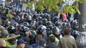 KYIV, UKRAINE - OCT 17, 2017: Detachment of policemen in helmets is preparing to disperse the crowd. 4k stock footage