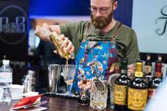 Kyiv, Ukraine - 30 october, 2016: Barman festival. Handsome bearded hipster with long beard and mustache holding shaker. Kyiv, Ukraine - 30 october, 2016: Barman stock photos