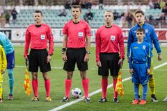 European Under-21 Chamionship match Ukraine - Netherlands. Kyiv, Ukraine - October 10, 2017: Referee Kristo Tohver and assistants Silver Koiv and Hannes Royalty Free Stock Photography