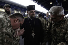 Kyiv, Ukraine - 14 October 2015: Ukrainian Orthodox chaplain of the Ukrainian Armed Forces royalty free stock photo