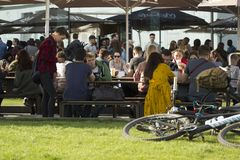Kyiv Ukraine - 21.04.2018: people eating and drinking at street restaurant in a sunny day in spring royalty free stock photo