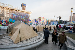 KYIV, UKRAINE: People walk past the army tents of the anti-government demonstrators during the pro-European protest Royalty Free Stock Photo