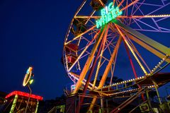 Kyiv - Ukraine, Poshtova square, 13.08.2018: Ferris wheel attraction illuminated with colorful lights in motion.  stock image