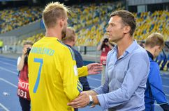 KYIV, UKRAINE - SEPT 5, 2016: Andriy Yarmolenko and Andriy Shevchenko shake hands during the FIFA World Cup 2018 qualifying game royalty free stock images