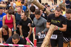 Public race with obstacles. Kyiv, Ukraine 2017 - September 2. A group of people are preparing to start in a public race with obstacles. Autumn royalty free stock photo
