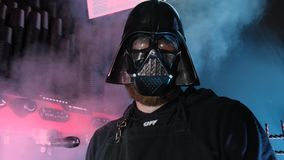 Portrait of a barman in Darth Vader mask. Steam and professional coffee machine behind his back. Star wars cafe concept. Kyiv, Ukraine - September, 2019 stock footage