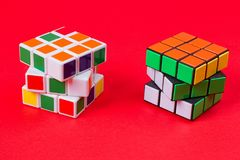Kyiv, Ukraine - September 20th, 2017: Rubik`s Cube on the pink. Rubik`s cube invented by Hungarian architect Erno Rubik in 1974 Royalty Free Stock Photos