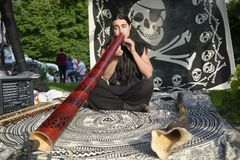 20.05.2018 Kyiv, Ukraine. Young musician playing didgeridoo on t. He traditional street music festival in Kiev Royalty Free Stock Images