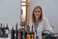 Kyiv Wine Festival by Good Wine in Ukraine. Woman sommelier Lucia Borri presents Brancaia wine at Kyiv Wine Festival booth. 77 winemakers from around the world Stock Images