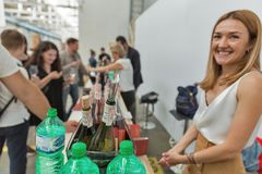 Kyiv Wine Festival by Good Wine in Ukraine. Woman sommelier presents its wines at Kyiv Wine Festival booth. 77 winemakers from around the world took part in the Stock Image
