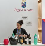 Kyiv Wine Festival by Good Wine in Ukraine. Woman sommelier presents Poggio di Sotto wine at Kyiv Wine Festival booth. 77 winemakers from around the world took Stock Image