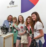 Kyiv Wine Festival by Good Wine in Ukraine. Man sommelier presents its Dr. Loosen wine at Kyiv Wine Festival booth. 77 winemakers from around the world took stock photography