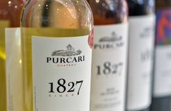 Kyiv Wine Festival by Good Wine in Ukraine. Moldavian wines Chateau Purcari closeup at Kyiv Wine Festival booth. 77 winemakers from around the world took part stock photography