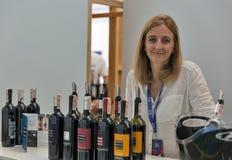 Kyiv Wine Festival by Good Wine in Ukraine. Woman sommelier Lucia Borri presents Brancaia wine at Kyiv Wine Festival booth. 77 winemakers from around the world Royalty Free Stock Photos