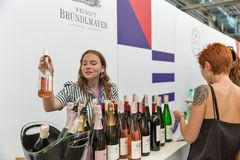 Kyiv Wine Festival by Good Wine in Ukraine. Woman sommelier presents its wine at Kyiv Wine Festival Brundlmayer booth. 77 winemakers from around the world took stock photography