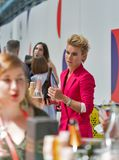 Kyiv Wine Festival by Good Wine in Ukraine. Young woman sommelier presents its wine at Kyiv Wine Festival. 77 winemakers from around the world took part in the Royalty Free Stock Images