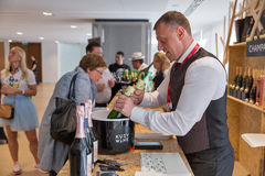 Kyiv Wine Festival in Kiev, Ukraine. Unrecognized people visit Champagne Bar at Kyiv Wine Festival organized by Good Wine company in Parkovy Exhibition Center Royalty Free Stock Image