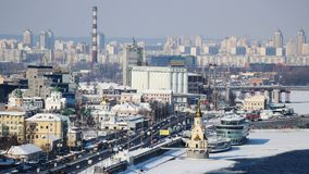 Kyiv in winter. View above Podil. St. Nicolas Wondermaker on The Water Church. Dnepr frozen bank. Dnipro frozen bank. Snow on top of the buildings stock photo