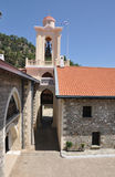 Kykkos monastery and the Greek flag Royalty Free Stock Images